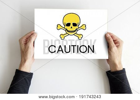 Hands holding placard skull icon and toxin dangerous word