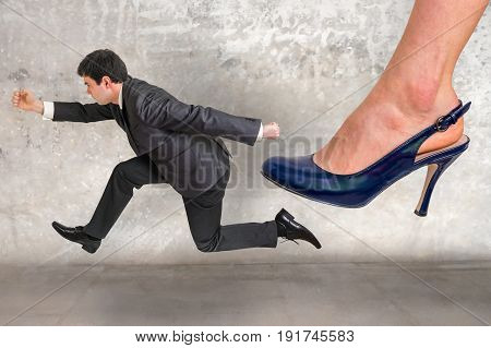 Small Businessman Running Away From A Boss Pressure