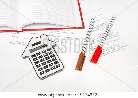 Calculator And Contract - Mortgage And Real Estate Concept