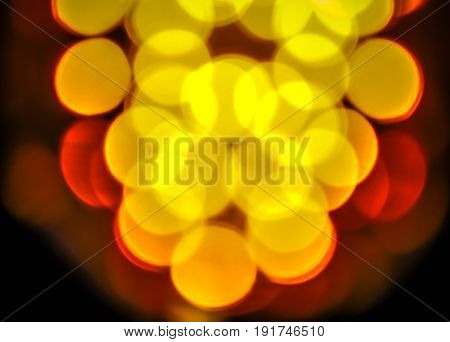 Abstract yellow colorful blur de focused background black, soft focus / De focused yellow and white bokeh twinkling lights background