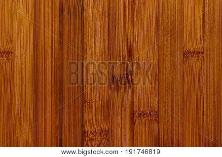 Bamboo brown wood texture vertical plank top view closeup.