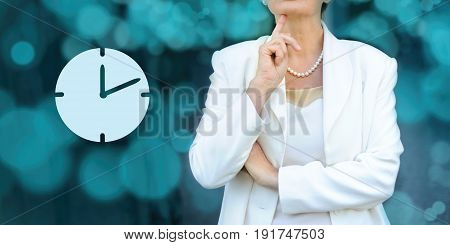 Time management and deadline concept. Senior businesswoman silhouette in bacground. Manager thinks about upcoming project deadline.