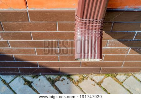 Close-up image of rain gutter downspout pipe