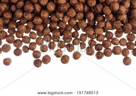 Decorative frame of chocolate balls corn flakes isolated with copy space background.