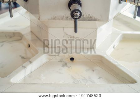 Closeup image of water tap on faucet in well-room