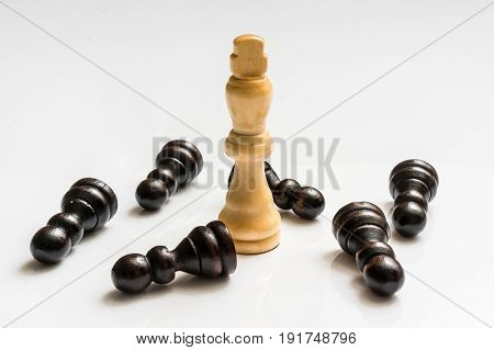 White King and many fallen pawns - chess leadership concept