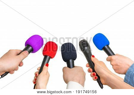 Hands Of Reporters With Many Microphones