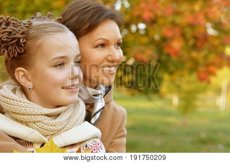 Portrait of a mother and daughter outdoors