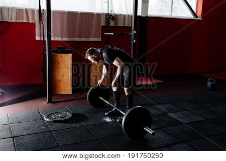 Bearded Man Putting Weights On Bar In Gym. Preparing To Workout With A Barbell. Bodybuilder Puts Wei