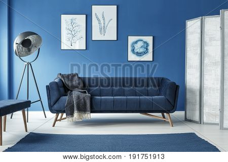Retro elegant room with vintage couch and lamp