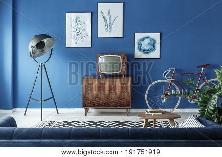 Vintage TV bike and retro lamp in modern living room