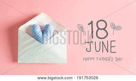 Father's Day message with a blue heart cushion in an envelope