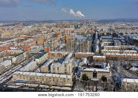 Tyumen, Russia - February 14, 2016: Aerial view onto residential area, office buildings of Sberbank and GEOTEK Seismic exploration with power station on background