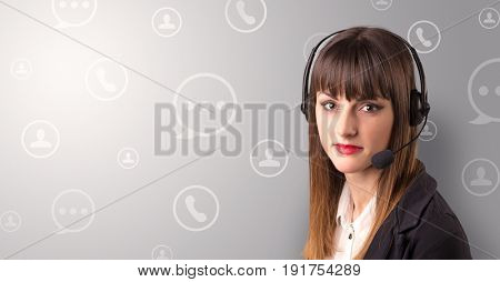 Young female telemarketer with white speech bubbles around her