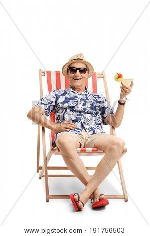 Elderly tourist with a cocktail sitting in a sun lounger isolated on white background