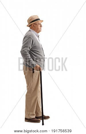 Full length profile shot of a senior with a cane waiting in line isolated on white background