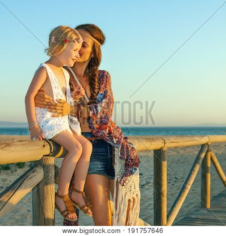 Mother And Daughter Outdoors In Summer Evening Having Fun Time
