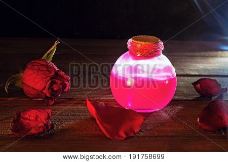 magical pink love potion in dark room