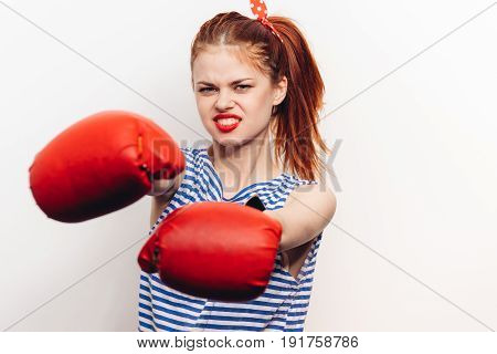 Woman in fighting gloves, woman in gloves, woman boxer.