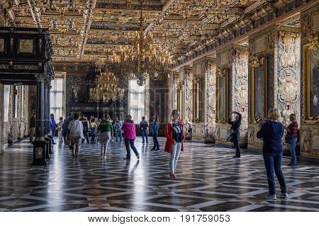 HILLEROD, DENMARK - JUNE 30, 2016: Tourists are visiting the Grand Knight's Hall of the Frederiksborg Castle.