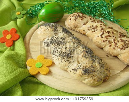 Eastern yeast braids bread with poppy seeds and linseeds
