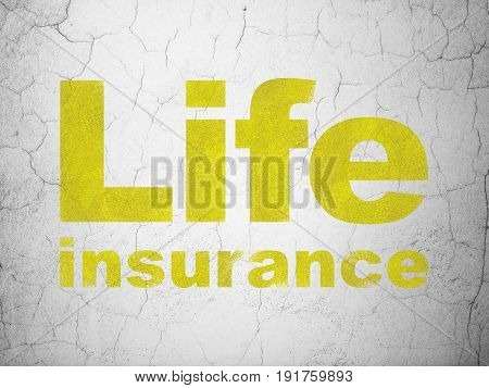 Insurance concept: Yellow Life Insurance on textured concrete wall background