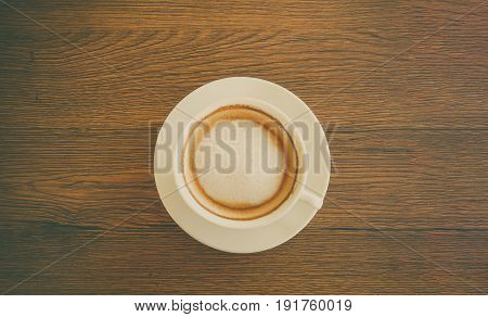 Top view close up cup of mocca coffee put on wooden table background with vintage filter.