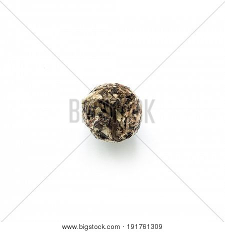 Flowering tea, one single bud sitting alone on a table, opens when brewed, topview