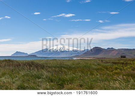 Beautiful Iceland Landscape With White Glacier Cap Of Snaefellsjokull Volcano On The Horizon. View F