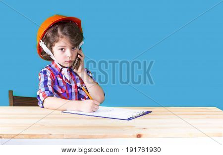 Young Serious Handsome Foreman In Helmet Holding A Phone, Wrote In Pencil In A Notebook. Close-up. B