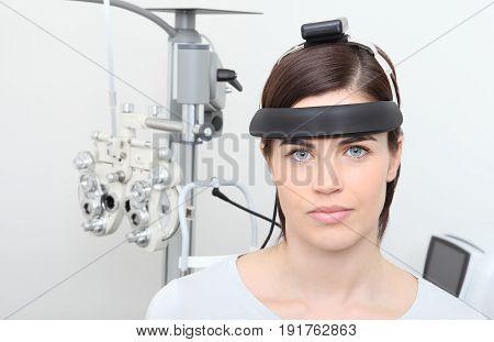 woman doing eyesight measurement isolated on white, balance test