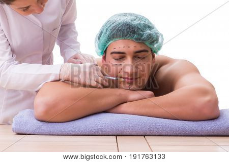 Handsome man in spa massage concept