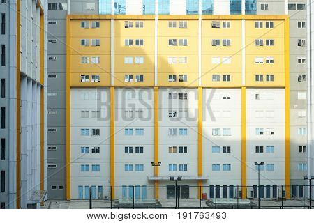 High glass window pattern of apartments building residential condo balconies structure urban facade for abstract business background