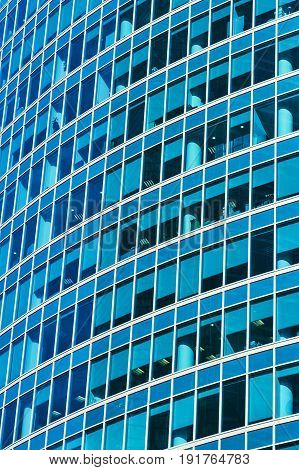 Background of blue windows of a modern office building. Tint blue