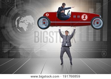 Businessman lifting sports car in power concept