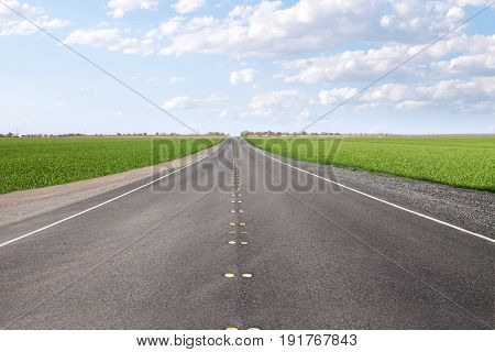 panoramic  view of nice summer empty road  through the valley