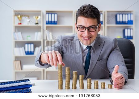 Businessman with golden coins in business growth concept