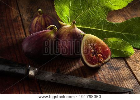 close up view of fresh figs on color back