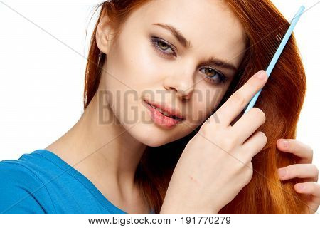 Woman combing hair comb, hair care, healthy hair on isolated background portrait.