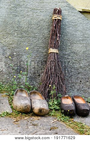 Regional tradition and culture handmade concept. Wooden dutch shoes traditional clogs footwear standing in row
