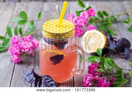 Cold and refreshing citrus fruit lemonade in mason jars
