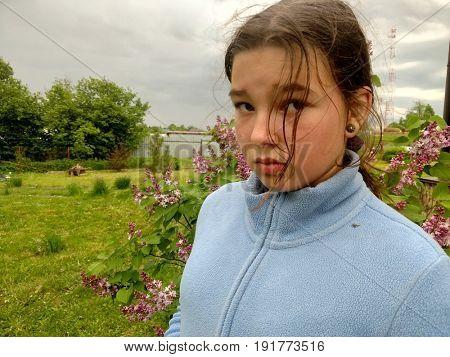 Sad girl teenager on the meadow
