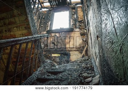 Staircase in the old abandoned burnt house