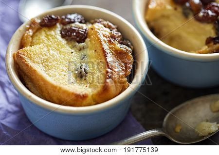 Bread and butter pudding with raisins in ramekins