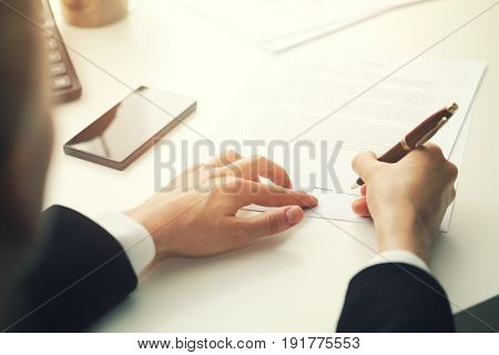 businesswoman putting signature on business partnership contract