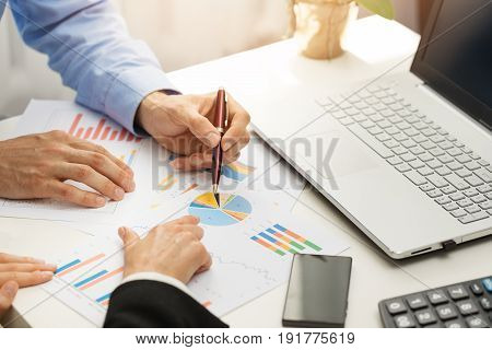 people at office analyzing business financial graph reports