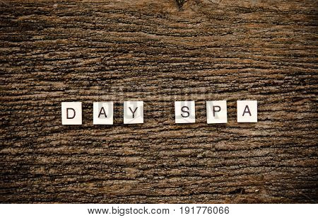 Day spa word collected of old wooden elements with the letters