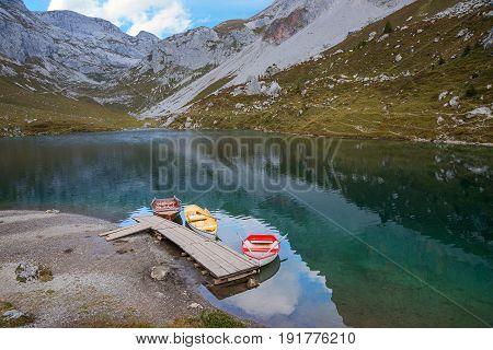 alpine lake partnun with rowing boats switzerland