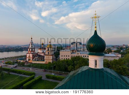 Cityscape of Irkutsk with orthodox church and river Angara at sunset