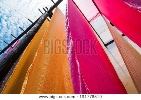 colorful fabric hanging to dry after traditional dye processshot in Heng Dian TownZhejiang province of China.